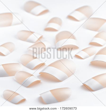 Set of brown false nails, isolated on white background