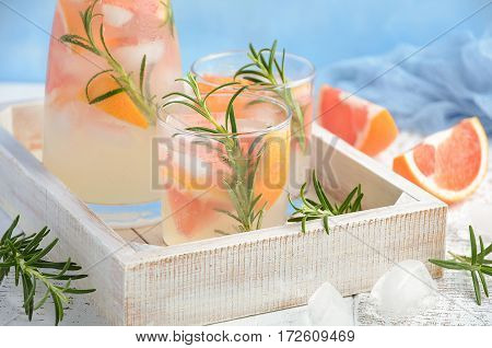 Summer refreshing drink with grapefruit and rosemary, selective focus