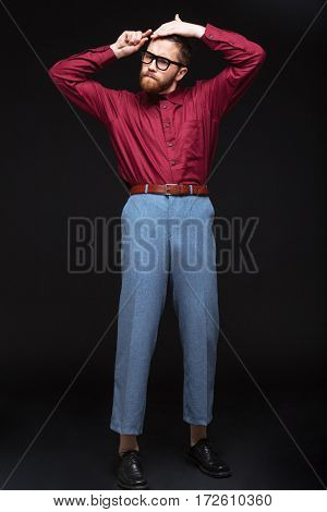 Vertical image of Male nerd in funny combing his hair