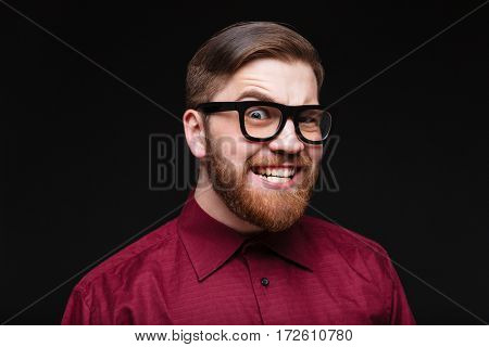 Close-up portrait of Male nerd in funny eyeglasses looking at camera