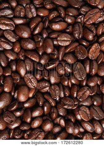 Roasted coffee beans beautiful vertical textured background