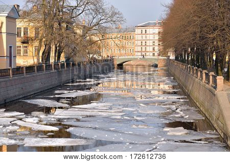 View of the Griboyedov Canal. Flow of the Neva delta in St. Petersburg at sunny spring day Russia.
