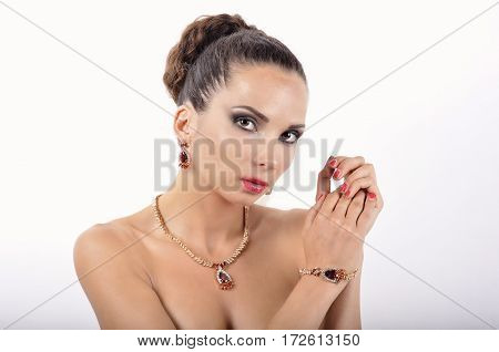 young girl in a necklace with red stone