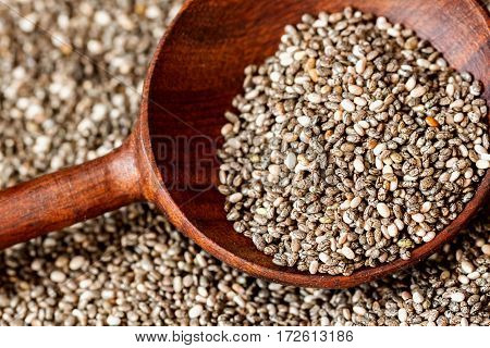 Close up Wooden spoon and Chia seeds. Healthy eating and detox concept.. For background, backdrop, substrate, composition use. Top view.