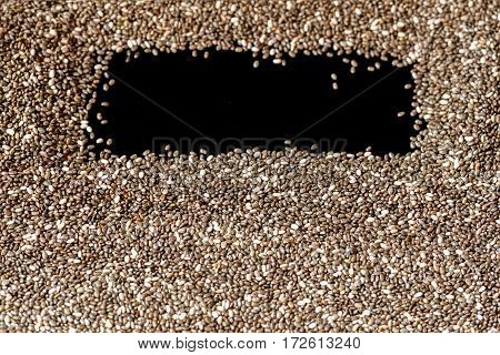 Close-up of Chia seeds, texture. Concept of healthy eating. For background, backdrop, substrate, composition use. Special black place for text