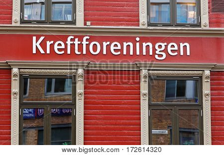 Trondheim Norway - September 30 2016: Exterior red wall with a sign for the Norwegian Cancer Society (Kreftforeningen) office located at the address Prinsens gate 32.