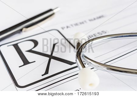 Medical prescription form with stethoscope and pen