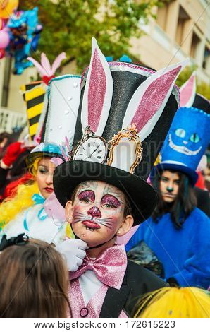 Portrait of kid at parade costumed characters through the streets of the city. FEBRUARY 17 2015 Torrevieja Spain.