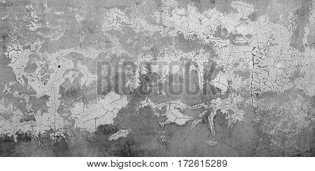 Background broken dirty old wall of painted rough plaster. Blank vintage surface texture. Design pattern of loft grunge surface.