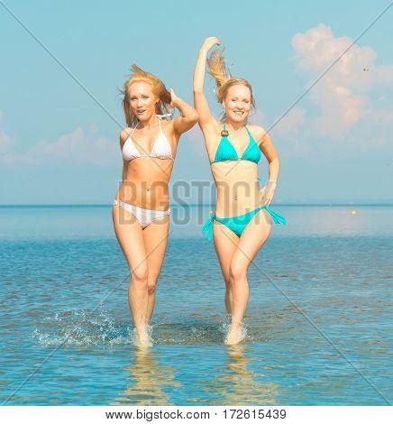 Models Running On a Beach