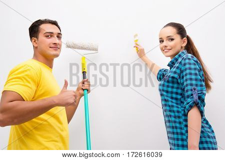 Young family painting the walls in DIY concept