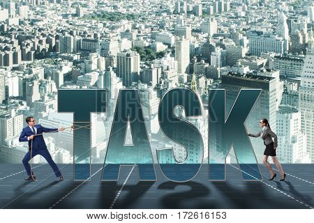 Businesswoman and businessman in task concept