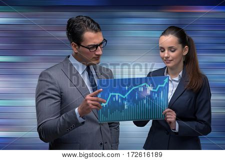 Businessman and businesswoman discussing trading strategies