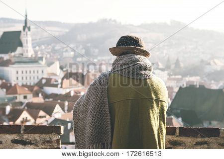 Lonely elderly woman traveler looking at the beautiful view of the town of Cesky Krumlov in the Czech Republic in Europe.