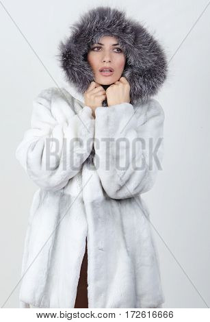 girl in a white fur coat with heaved up a collar