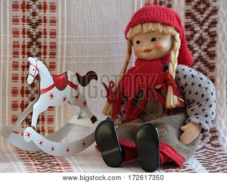 puppet sitting beside rocking horse close up