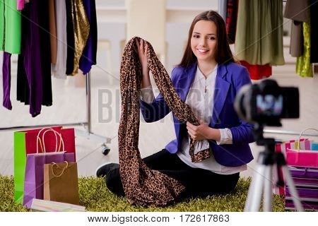 Fashion blogger recording video for blog