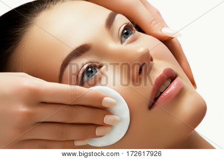 Portrait Of Happy Smiling Beautiful Young Woman Cleaning Skin By Cotton Pad, At Spa Salon. Beautiful