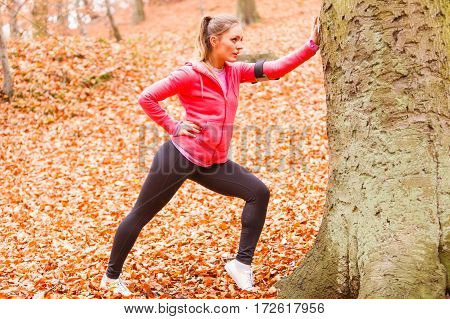 Dynamic Girl Stretching In Forest.