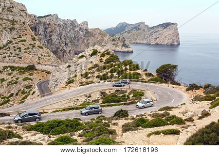MAJORCA/ SPAIN - JUNE 12. The cars on the mountain road of the Cape Formentor as seen from the Formentor lighthouse on June 12, 2016. Island Majorca, Spain.