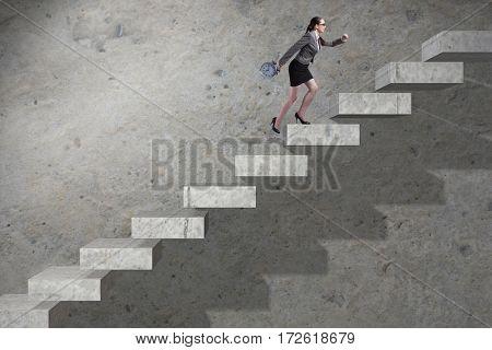 Young businesswoman climbing career ladder