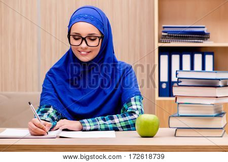 Muslim girl preparing for entry exams