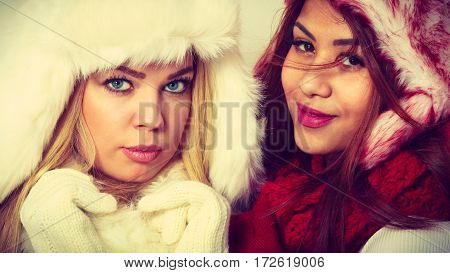 Two Girls In Warm Winter Clothing Portrait.