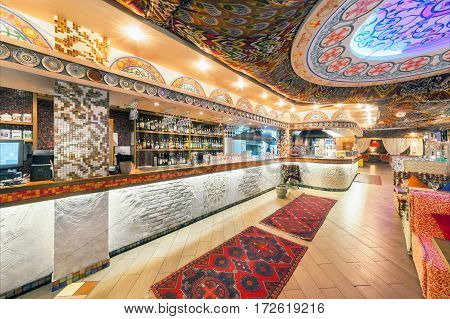 MOSCOW - AUGUST 2014: Interior Chaihana Lounge Eastern restaurant in a traditional style. The main hall with bar and open kitchen