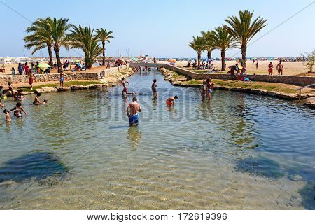 COMARRUGA/ SPAIN - JULY 31, 2016. Thermal spring at Comarruga (Coma Ruga) beach. El Vendrell, Catalonia, Spain