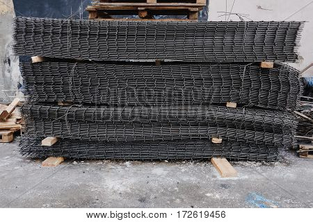 metal construction mesh is folded onto pallets