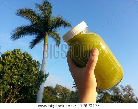 Mason jar of tropical green juice cleanse for health and healing