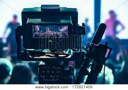 Shooting concert professional camera. View of the video camera viewfinder.