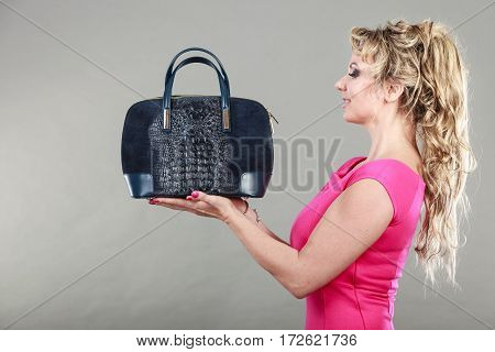 Elegant Woman Buyer With Dep Blue Bag.