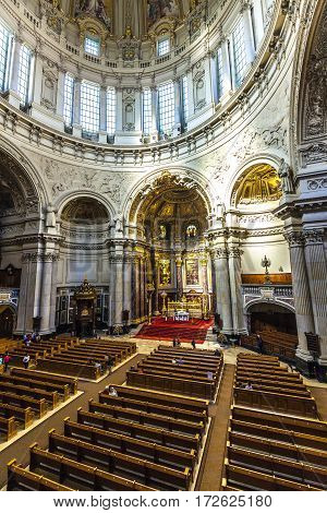 BERLIN GERMANY - MAY 2 2016: people visit the Berliner Dom from inside. the dome is the biggest church in Berlin and the center of protestand religion in Germany.