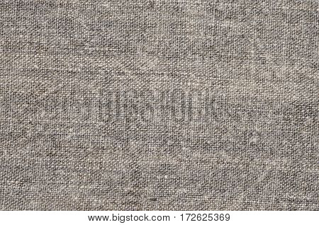 Homespun hemp cloth. Close-up of texture fabric cloth textile background. Homespun hemp fabric material. Homespun hemp canvas. Natural authentic cloth