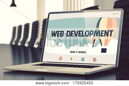 Laptop Screen with Web Development Concept on Landing Page. Closeup View. Modern Meeting Room Background. Toned Image. Blurred Background. 3D Render.