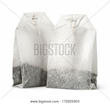 Two tea bags with thread vertically isolated on white background