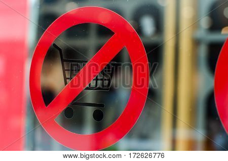sign ban entry into the store with a grocery cart. crossed-out icon on the window glass