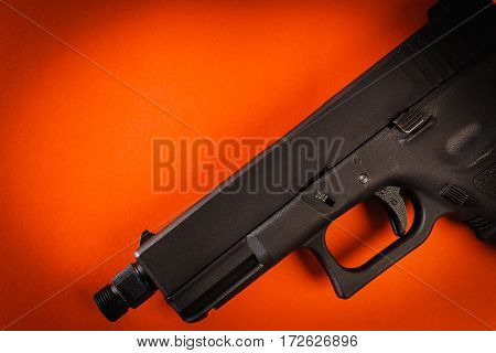 one black handgun on intense red background