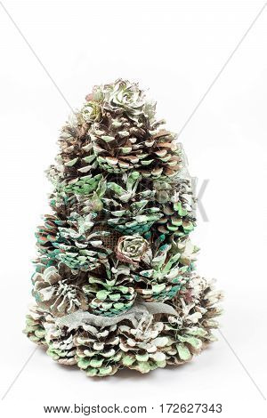 Christmas Tree Made Of Pinecones Over White Background With Copy