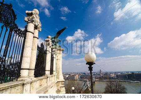 Budapest, Hungary - February 20, 2016: Eagle Statue on Castle Wall in Budapest. Buda Castle, also known as the Royal Palace, is included in the Budapest UNESCO World Heritage Site
