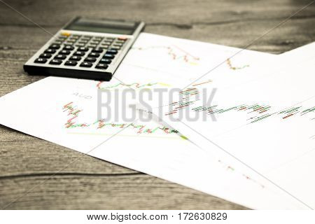 calculator on graffica the Dow Jones on forex market at grey table