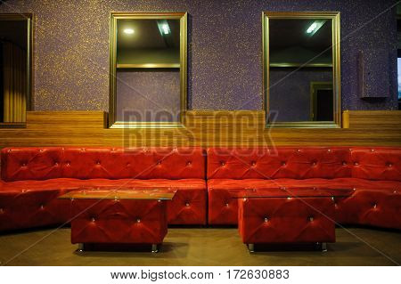 Vintage Iterior With Red Leather Sofa