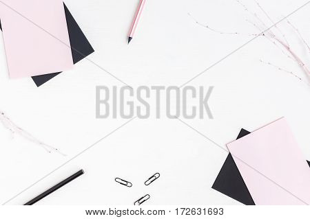 Feminine workspace with paper blank pencils. Business concept. Flat lay top view