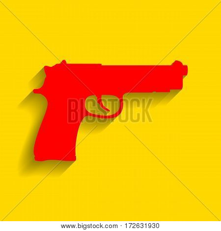 Gun sign illustration. Vector. Red icon with soft shadow on golden background.