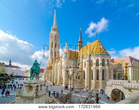 BUDAPEST, HUNGARY - FEBRUARY 20, 2016: Matthias Church is a Roman Catholic church located in Budapest, Hungary, in front of the Fisherman's Bastion at the heart of Buda's Castle District