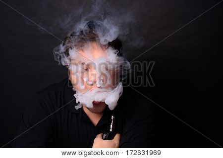 Low Key Shot of an Adult Male Vaping