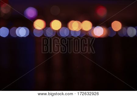 Interesting bokeh on the waterfront of the city at night