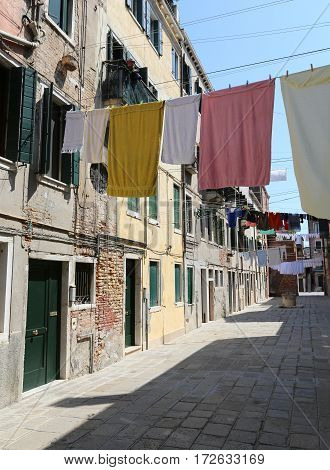 Venice Italy so many clothes hanging in the large street called Calle in italian