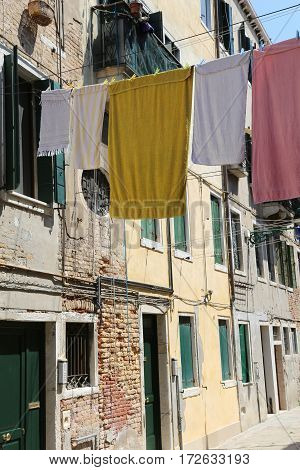 Venice Italy so clothes hanging in the street called Calle in italian